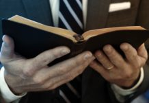 A Christian holding a Bible