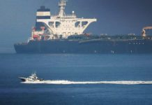 A Spanish Civil Guard boat sails past Iranian oil tanker