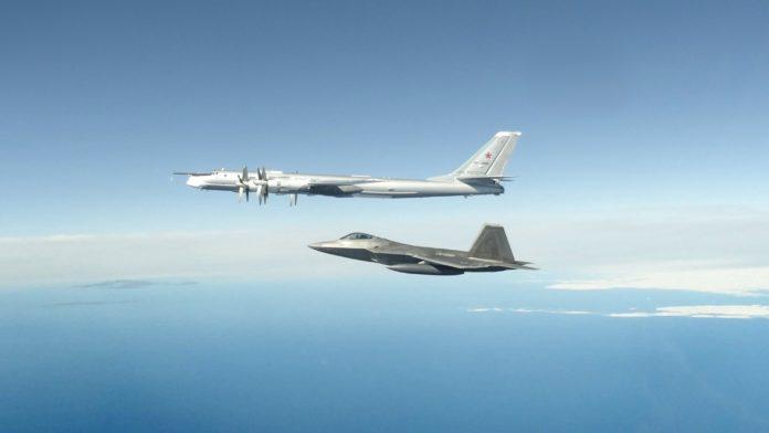 A US Air Force F-22 intercepting a Russian Tu-95 bomber