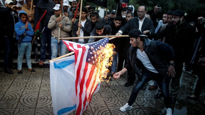 Palestinians burned an Israeli and a US flag during a protest in Gaza City.